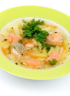 Green plate of fish soup with salmon cod trout potato for Fish soup cod