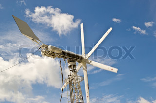 windmills against a blue sky, alternative energy source