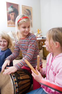 Children playing with different musical instruments