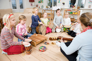 A group of children learning to play musical instruments