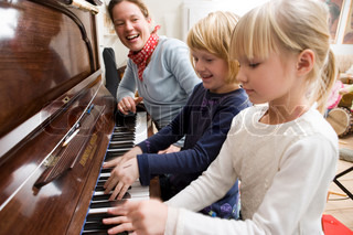 Young girls learning to play the piano