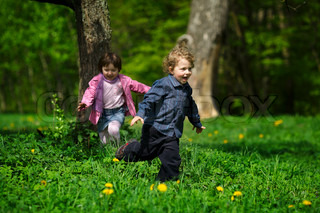 little boy and girl running away