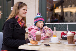 Mother and daughter on a cafe
