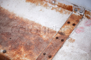 Industrial abstract rusted element with bolts