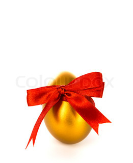 Gold easter egg with red bow on a white background