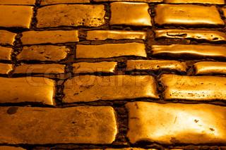 Illuminated Golden Cobblestones of Rovinj, Croatia