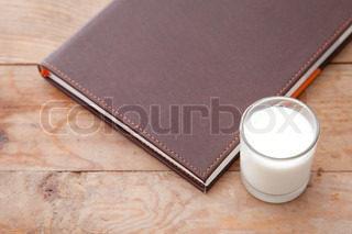 Book and milk on the table