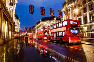 Red Bus on the Rainy Street of London in the Night, United Kingdom
