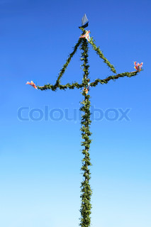 finnish midsummer pole against blue sky