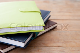 Notebook stack on wood table