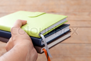 Notebook in a hand