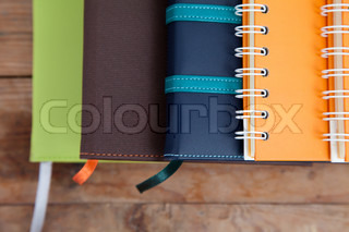 notebook stack on wood background