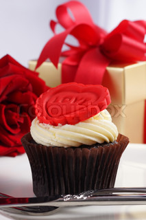 Valentine cupcake with red rose and gift box