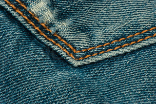 Blue jeans with orange thread
