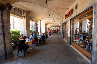 Tourists in sidewalk cafes in Genoa, Italy