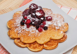 Wafers with berries and powdered sugar