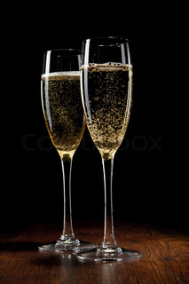 two glass with champagne on a wooden table stock photo colourbox. Black Bedroom Furniture Sets. Home Design Ideas