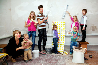 Big family making repairs to their new home