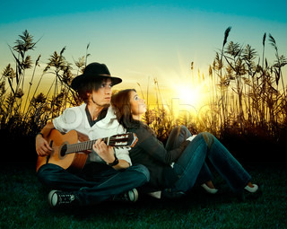 Love story A young man playing guitar for his girl