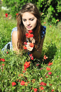 girl on meadow with poppy