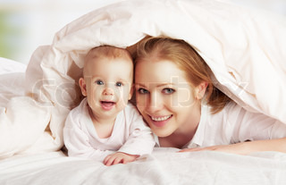 happy family Mother and baby playing underblanket