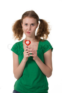 closeup shot of girl with red heart lollipop isolated on white