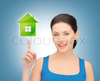 woman pointing her finger on green house