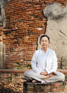 woman meditating in temple