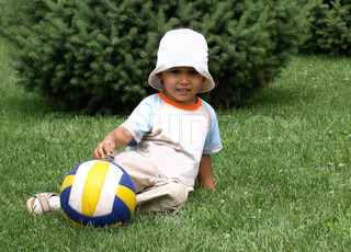 boy relaxing with ball