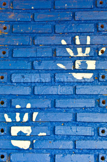 The White hand print on blue wallbackground texture
