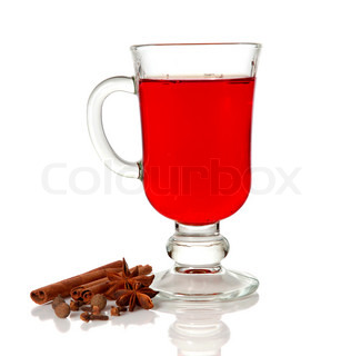 Hot mulled wine in glass cup and spice on white background