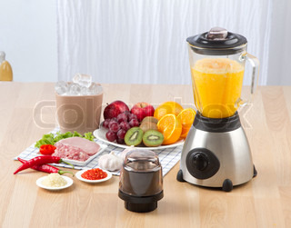 electric blender display with fruit and meat