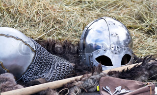 knight's helmet on a background of hay