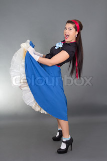 funny brunette woman in retro clothes