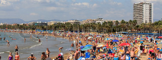 People on a beach in Salou, Spain