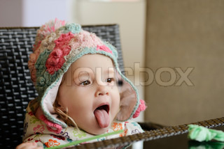 baby girl showing tongue