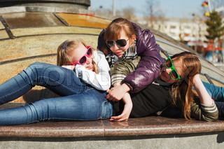 Teenage girls relaxing on a city street