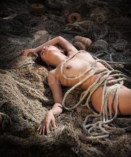 naked woman and a fishing net