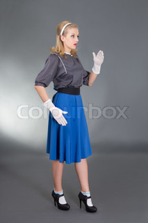 young beautiful pinup girl over grey background