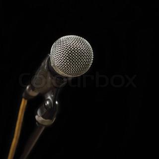 Grey iron microphone on black background
