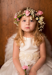 portrait of little girl with angel wings