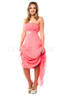 Beautiful woman holding up her party dress