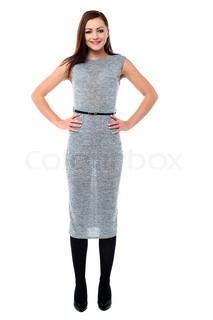 Stylish young woman with hands on waist