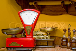 Red kitchen scales in the old style