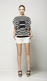 Full Length of Trendy Woman in Shorts and Grey Striped Shirt Casual Modern Collection
