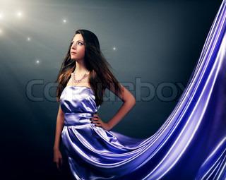 Beautiful girl in violet long dress