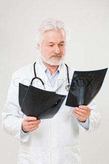 Handsome elderly doctor with radiograph