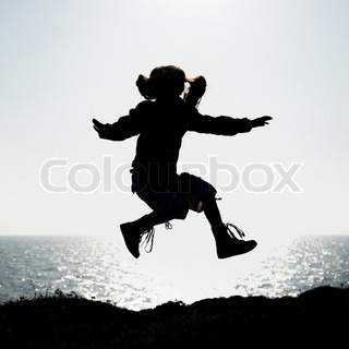 silhouette of a little girl jumping