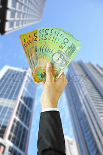 Businessman holding money - Australian dollars AUD