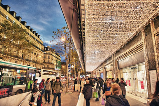 PARIS - NOV 28: Tourists walk along city streets, November 28, 2012 in Paris 50 million people visit the city every year
